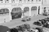 Singapore, aerial view of truck driving past John Little department store