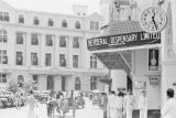 Singapore, street scene in front of The Federal Dispensary Limited and Chartered Bank