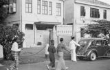 Singapore, people walking in front of the Young Women's Christian Association