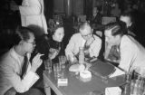 Singapore, group of unidentified people at table in club