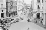 Singapore, view of city street with automobiles, pedestrians and businesses
