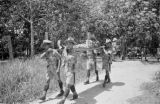 Malaysia, soldiers carrying a wounded soldier on stretcher