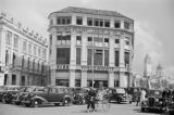 Singapore, cars in front of Whiteaway Laidlaw & Co. department store