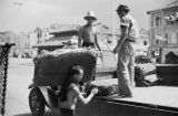 Singapore, men loading sheets of rubber on truck