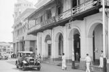 Singapore, street scene in front of buildings with O.S.K. Line offices