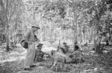 Malaysia, man with camera speaking with soldiers