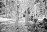 Malaysia, unidentified Western woman and man speaking with soldiers