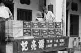 Singapore, truck loaded with crates of imported California sardines