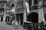 Singapore, street scene in front of import shop with Japanese flag