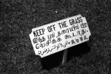 Singapore, 'Keep off the grass' sign in three languages