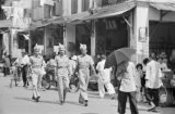 Singapore, military personnel walking in business district