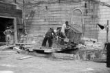 Hong Kong (China), laborers using skip to mix and pour concrete or mortar for construction