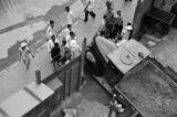 Hong Kong (China), aerial view of men looking at truck in construction site