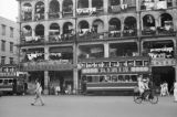 Hong Kong (China), street scene with trolley and laundry hanging from balconies