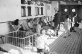 Hong Kong (China), women and children evacuees on ship deck