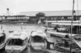 Hong Kong (China), sampans and passenger boats in harbor with pier in background