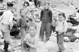 Lanzhou (China), children gathered on rocky river bank