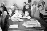 Sian (China), boys sitting at tables in classroom