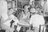 Singapore, men with artificial wounds eating meal at restaurant