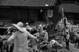 Kobe (Japan), people sorting through debris from flood damage