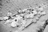 Korea, women washing clothes on stones