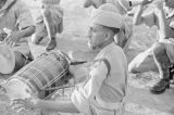 Singapore, member of the 15th Punjab Regiment playing drums during war dance