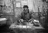 Chongqing (China), street vendor, possibly selling transcription services