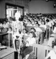 Bangkok (Thailand), students in lecture hall of medical college with skeleton