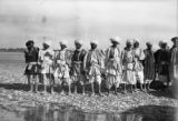Afghanistan, group portrait of men standing by river in Qandahār province