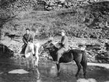 Shaanxi province (China), Cheng brothers on horseback in icy stream