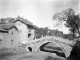 Shanxi province (China), bridge crossing stream in village
