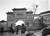China, Frederick G. Clapp in rickshaw at city gate near Wuhan