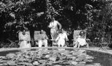 Tehran (Iran), Helen and Clara Clapp with others beside reflecting pool at Pension Persepolis