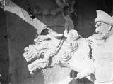 Yan'an (China), sculpture of lion and guardian in Ten-Thousand Buddha Cave in Qingliang Mountain