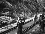 Israel, girls selling flowers along tracks at railroad station