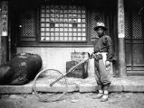 Shaanxi province (China), portrait of man with surveyor's wheel