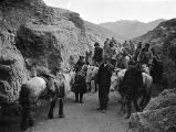 China, Frederick G. Clapp's traveling party on mountain path