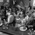Japan, girls making floral arrangement in class