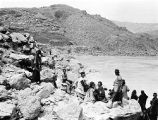 Masjed Soleymān (Iran), members of the Bakhtiari tribe among rocky shore of Kārūn River