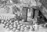 Pakistan, men placing pots in yard for drying in Lahore