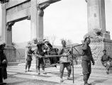 Changping (China), Helen Clapp being carried in sedan chair in front of gateway leading to Ming...