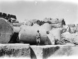 Ba'labakk (Lebanon), man standing before ruins of ancient Roman city