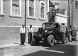 Beirut (Lebanon), men standing near truck outside Hotel Metropole