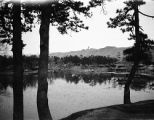 Chengde (China), lake view at Chengde Mountain Resort with Sledge Hammer Peak in distance