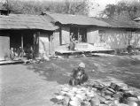 Golestān province (Iran), village scene with man and metal pots