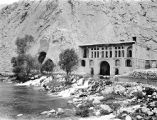 Ţāq-e Bustān (Iran), view of Sassanian rock carvings and brick building at the foot of the...