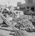 Pakistan, carrot vendor on city street in Karāchi