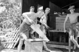 Hong Kong, Argyll and Sutherland Highlanders soldier cutting wood with saw