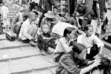 Hong Kong, people sitting along stepped street