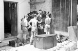 Hong Kong, Argyll and Sutherland Highlanders soldiers looking at supplies